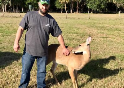 Bryon with a Deer at Triple Tree Ranch
